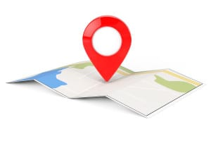 Folded Abstract Navigation Map with Target Pin on a white background