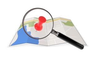 Paper Map with Magnifying Glass and Push Pin